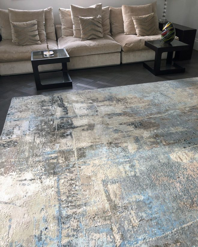 blue and beige abstract rug in living room